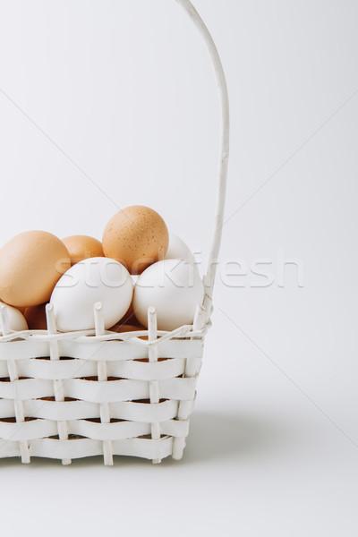 Blanche brun oeufs osier panier Photo stock © LightFieldStudios