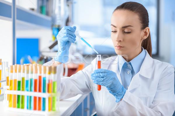 portrait of serious scientist working with laboratory tube Stock photo © LightFieldStudios