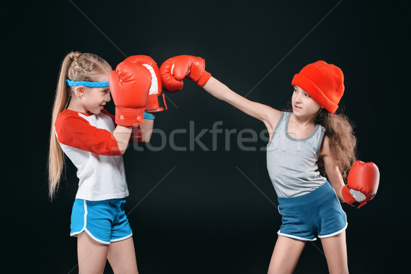 side view of sportive girls pretending boxing isolated on black, active kids concept Stock photo © LightFieldStudios