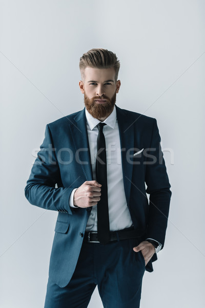 Confident bearded businessman in stylish suit looking at camera  Stock photo © LightFieldStudios