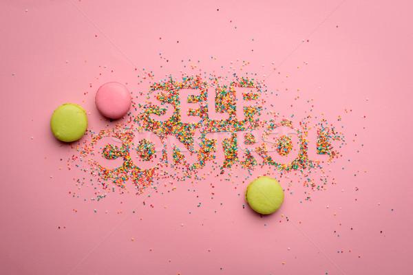 Top мнение контроль конфеты изолированный розовый Сток-фото © LightFieldStudios