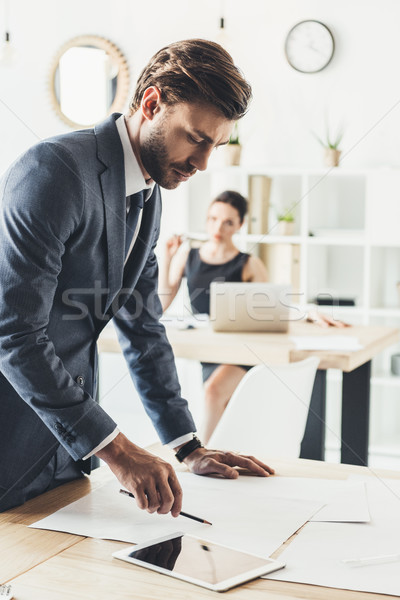 businessman checking papers Stock photo © LightFieldStudios