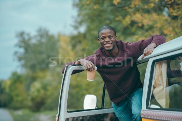 afro man with coffee in minivan Stock photo © LightFieldStudios