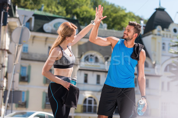 sportswoman and sportsman giving highfive  Stock photo © LightFieldStudios
