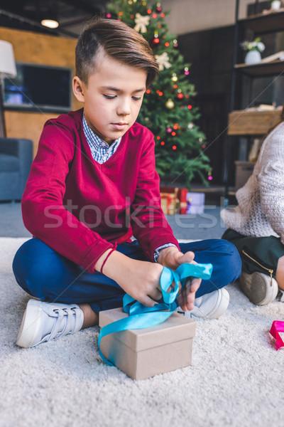 Fiú karácsony ajándék koncentrált kicsi ül Stock fotó © LightFieldStudios