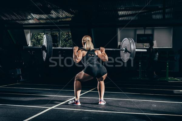 スポーツウーマン バーベル 背面図 ショット 小さな ストックフォト © LightFieldStudios