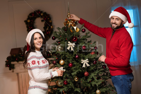 couple decorating christmas tree Stock photo © LightFieldStudios
