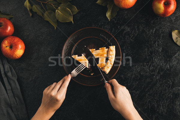 woman cutting apple pie Stock photo © LightFieldStudios