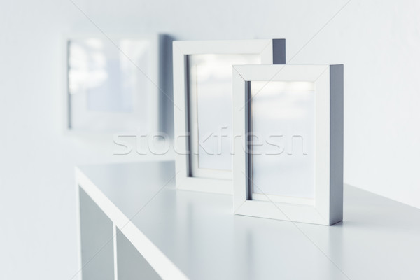 empty photo frames on bookshelf  Stock photo © LightFieldStudios