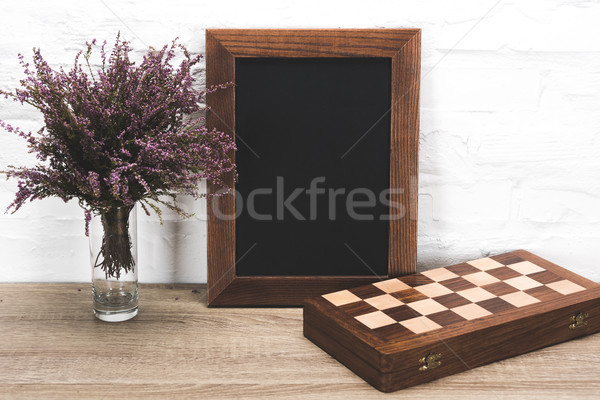 photo frame and chess board on table Stock photo © LightFieldStudios