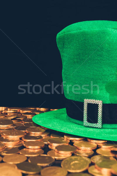 green hat on shining golden coins isolated on black, st patricks day concept Stock photo © LightFieldStudios
