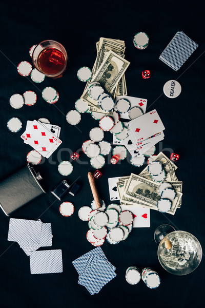 Gambling concept with alcohol on casino table with cards and dice Stock photo © LightFieldStudios