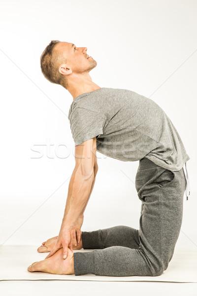 Man standing in yoga pose   Stock photo © LightFieldStudios