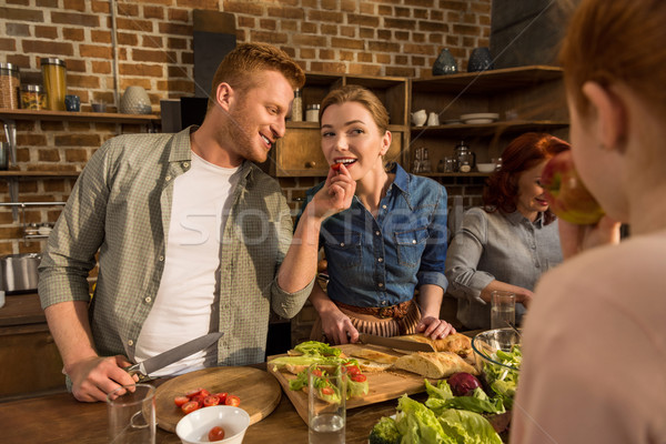 wife and husband cooking together Stock photo © LightFieldStudios