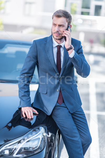 businessman with smartphone at car Stock photo © LightFieldStudios