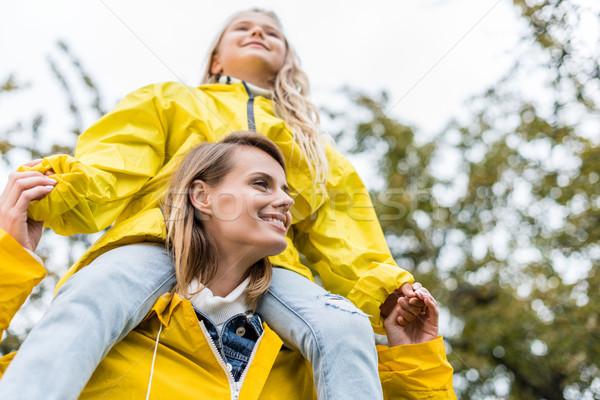 mother piggybacking her daughter Stock photo © LightFieldStudios