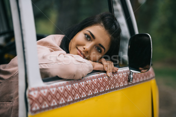 smiling girl in retro minivan Stock photo © LightFieldStudios