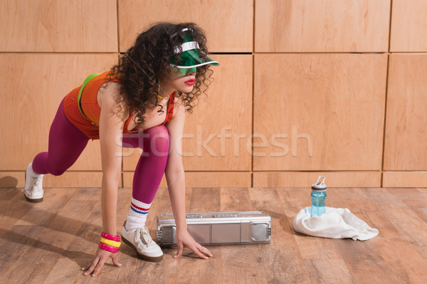 Stock photo: woman stretching before training
