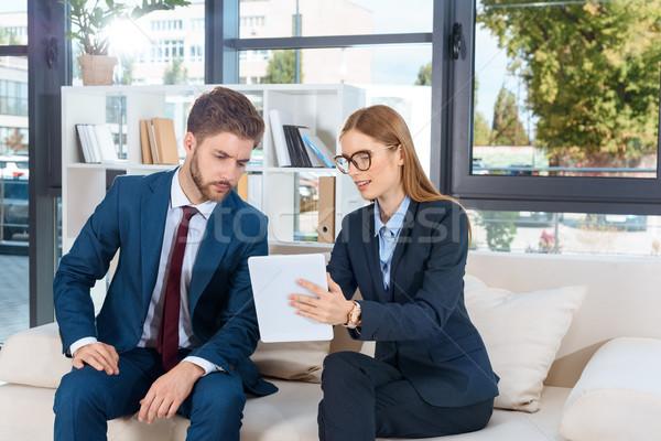 business people with digital tablet Stock photo © LightFieldStudios