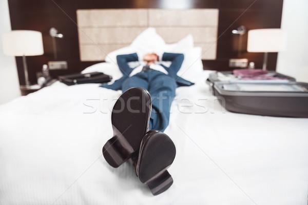 Kimerült üzletember ágy fiatal hivatalos öltöny Stock fotó © LightFieldStudios