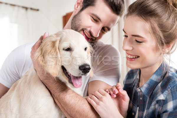 Stock photo: Young couple with puppy