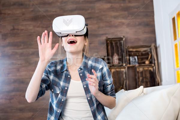 Femme réalité casque jeunes excité Photo stock © LightFieldStudios