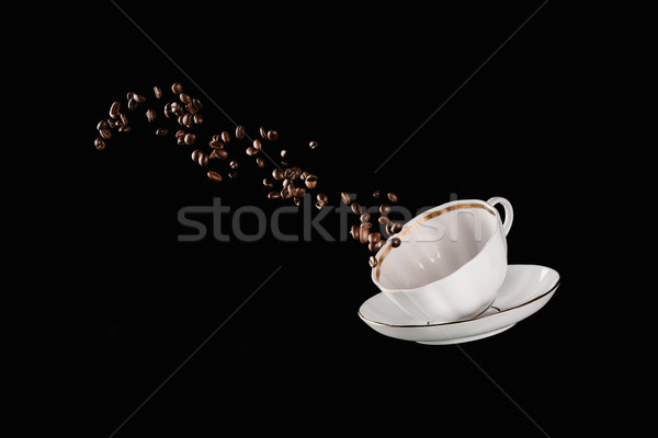coffee beans falling from cup isolated on black Stock photo © LightFieldStudios