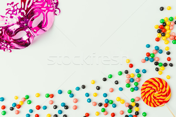 flat lay with arranged masquerade mask, lollipop and sweets isolated on white Stock photo © LightFieldStudios
