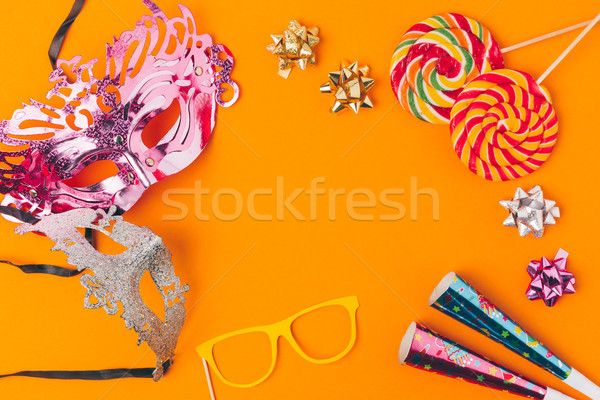 flat lay with lollipops and party objects isolated on orange, purim holiday concept Stock photo © LightFieldStudios