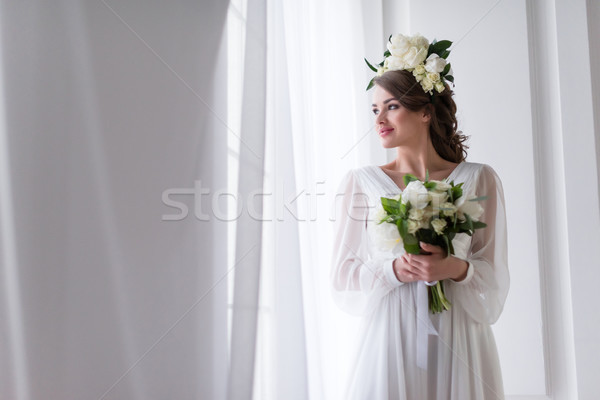 attractive bride in elegant dress and floral wreath holding wedding bouquet  Stock photo © LightFieldStudios