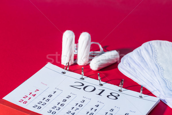 tampons, daily liners and calendar on red Stock photo © LightFieldStudios