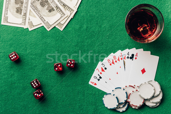 Gambling concept with with cards and dice on casino table  Stock photo © LightFieldStudios