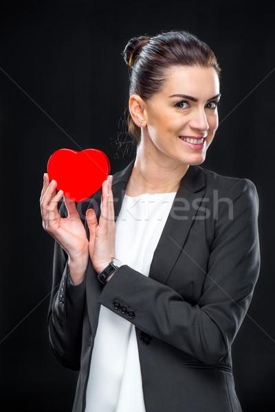 Businesswoman holding red toy heart  Stock photo © LightFieldStudios