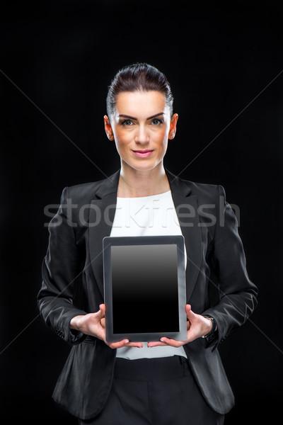Zakenvrouw tonen digitale tablet aantrekkelijk glimlachend Stockfoto © LightFieldStudios