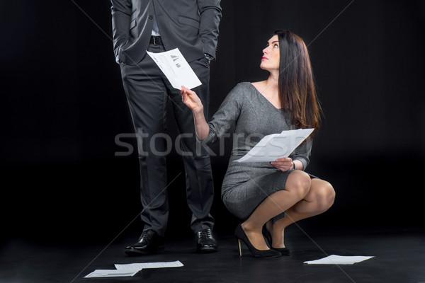 Businesswoman with dropped documents Stock photo © LightFieldStudios