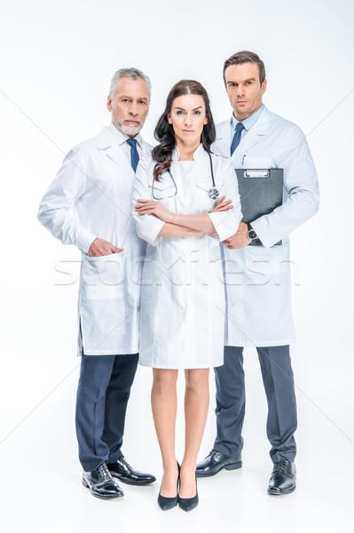 Three confident doctors Stock photo © LightFieldStudios