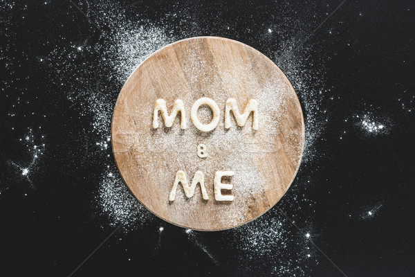 Top view of edible lettering mom and me made from cookies on wooden cutting board, baking cookies co Stock photo © LightFieldStudios