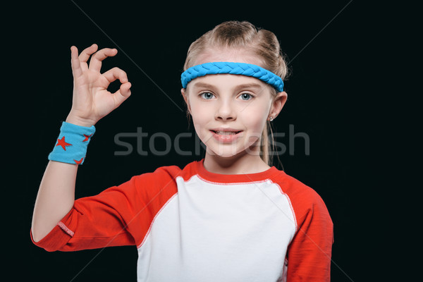 Portrait of cute blonde girl in sportswear showing ok sign and smiling at camera, activities for chi Stock photo © LightFieldStudios