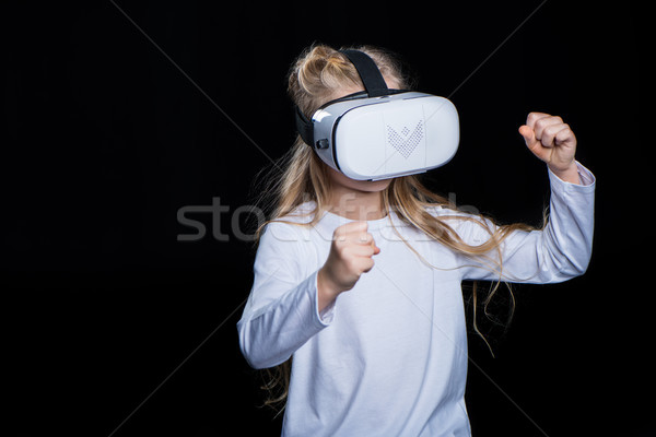 Girl in virtual reality headset Stock photo © LightFieldStudios
