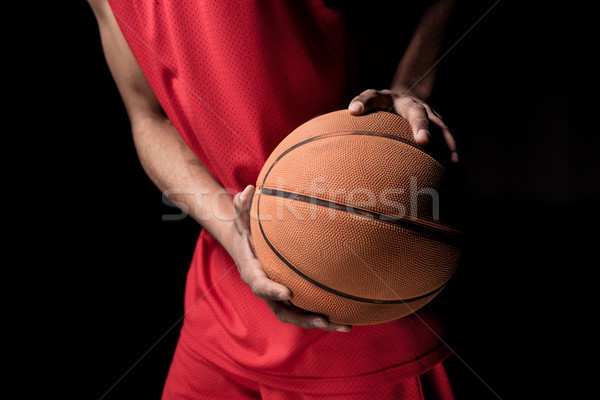 Close-up partial view of young sporty man holding basketball ball Stock photo © LightFieldStudios