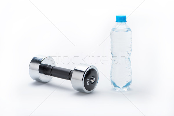 metallic dumbbell and bottle with water isolated on white. drink water, equipment sport and healthy  Stock photo © LightFieldStudios