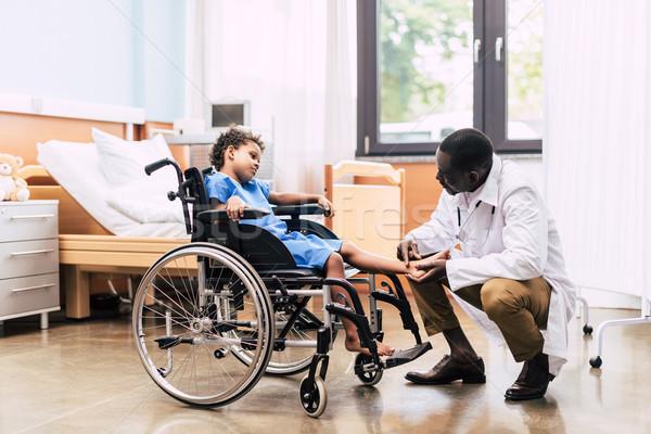 афроамериканец врач инвалидов пациент вид сбоку Сток-фото © LightFieldStudios