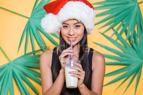 Vrouw hoed drinken glimlachend asian Stockfoto © LightFieldStudios