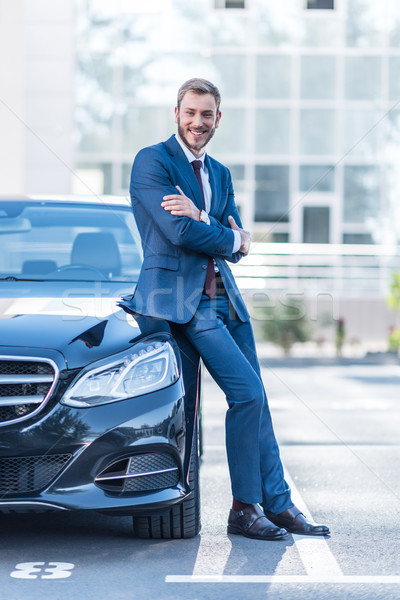 Stock photo: businessman at car on parking