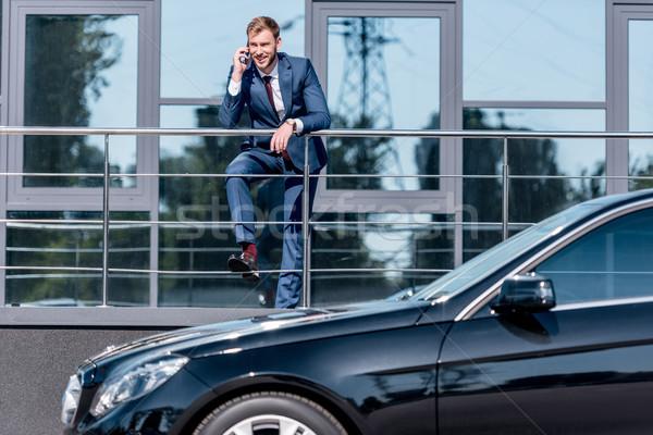 ビジネスマン オフィスビル 車 スタイリッシュ スーツ スマートフォン ストックフォト © LightFieldStudios