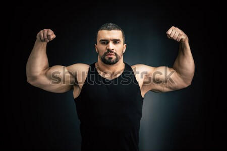 Stock photo: strong man showing muscles