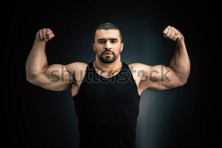 Fort homme muscles portrait isolé Photo stock © LightFieldStudios