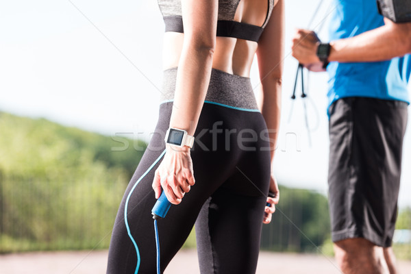 sportswoman and sportsman with skipping ropes Stock photo © LightFieldStudios