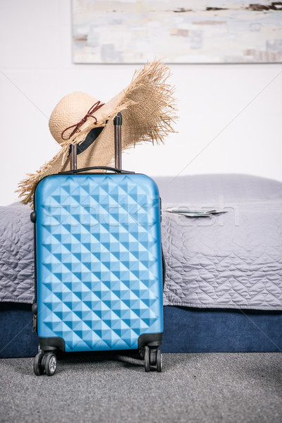 suitcase with straw hat Stock photo © LightFieldStudios