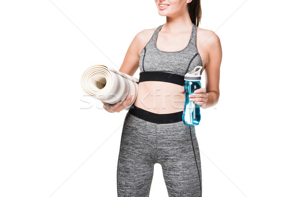 sportswoman with yoga mat and bottle of water Stock photo © LightFieldStudios